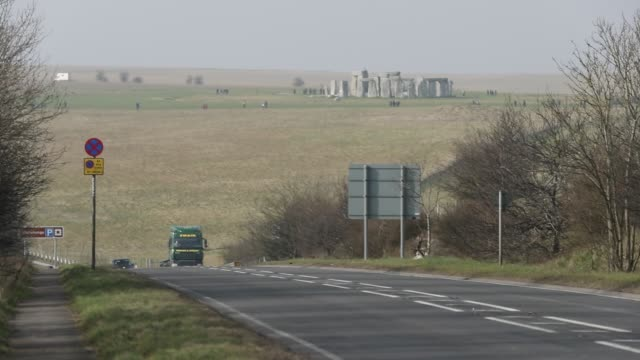 Traffic passes along the busy A303 that runs besides the ancient neolithic monument of at Stonehenge on February 21 2018 in Wiltshire England...