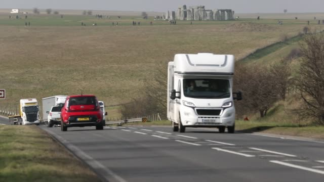 traffic passes along the busy a303 that runs besides the ancient neolithic monument of at stonehenge on february 21, 2018 in wiltshire, england.... - wiltshire stock videos & royalty-free footage