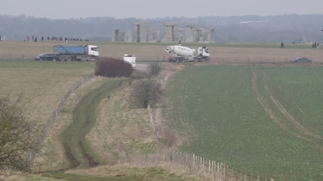 traffic passes along the busy a303 that runs besides the ancient neolithic monument of at stonehenge on february 21 2018 in wiltshire england... - unesco stock videos & royalty-free footage