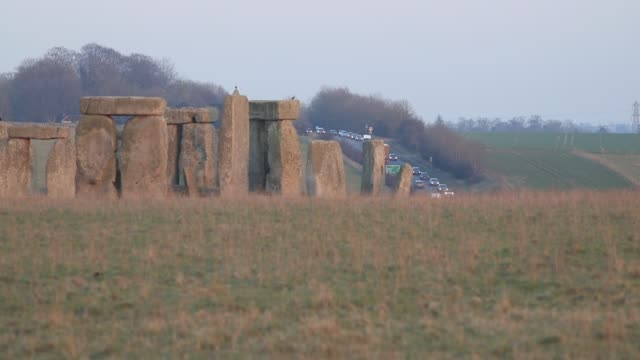 Traffic passes along the busy A303 that runs besides the ancient neolithic monument of at Stonehenge on February 22 2018 in Wiltshire England...