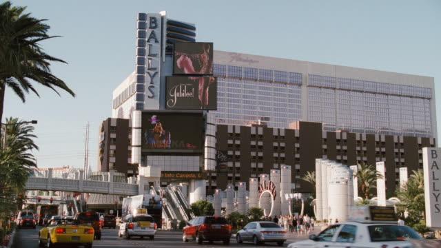 traffic passes bally's hotel and casino in las vegas, nevada. - bally's las vegas stock videos & royalty-free footage