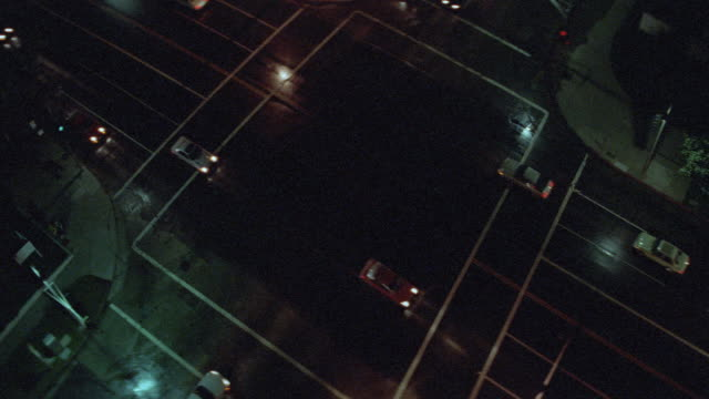 vídeos de stock e filmes b-roll de traffic passes below a multistory building. - peitoril de janela