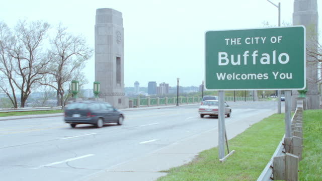traffic passes by a welcome sign upon entering buffalo, new york. - 2003 stock videos & royalty-free footage