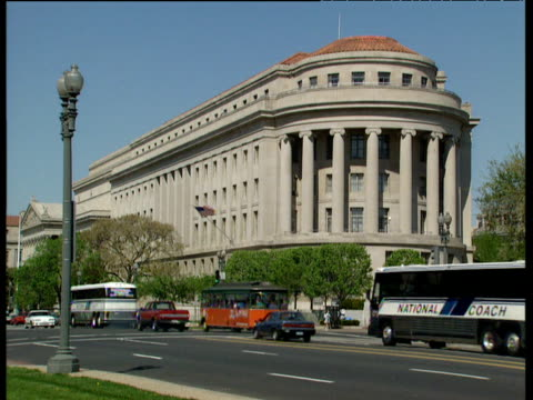 traffic passes by federal trade committee building - federal building stock videos and b-roll footage
