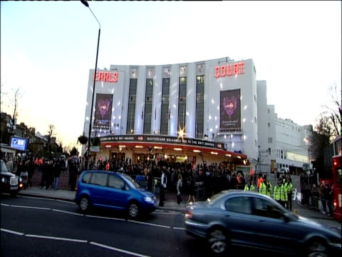 traffic passes by large crowd outside earls court for brit awards - earls court stock videos & royalty-free footage