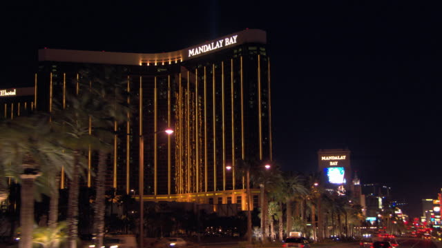 traffic passes by mandalay bay resort and casino. - mandalay bay resort and casino stock videos & royalty-free footage