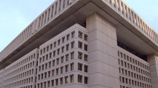 traffic passes by the j. edgar hoover building in washington, d.c. - fbi stock videos & royalty-free footage
