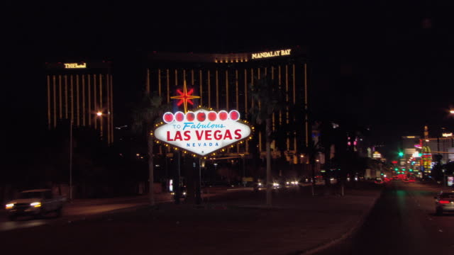Traffic passes by the, Welcome to Fabulous Las Vegas sign located at the southern end of Las Vegas Boulevard.