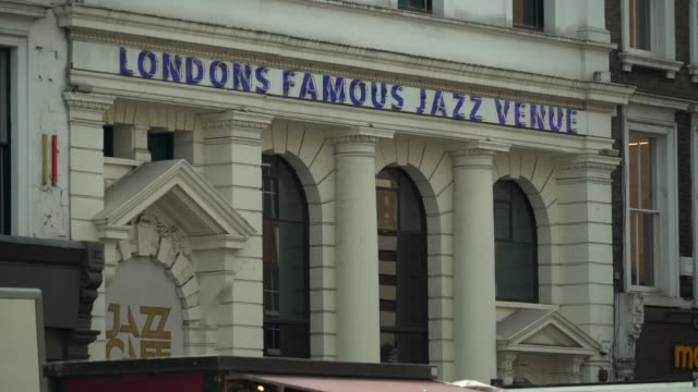 traffic passes exterior of the jazz cafe, camden town - jazz stock videos & royalty-free footage