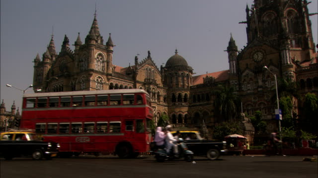 traffic passes in front of majestic chhatrapati shivaji terminus mumbai available in hd. - former stock videos and b-roll footage