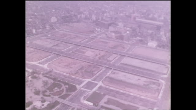 vídeos y material grabado en eventos de stock de traffic passes newly zoned redevelopment land for the yodobashi purification plant in postwar tokyo. - expansión urbana