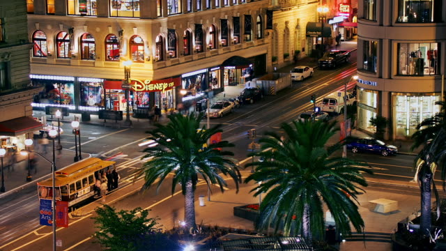 traffic passes on the streets in union square in san francisco, california. - disney stock videos and b-roll footage
