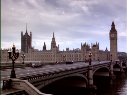 Traffic passes over Westminster Bridge in London.