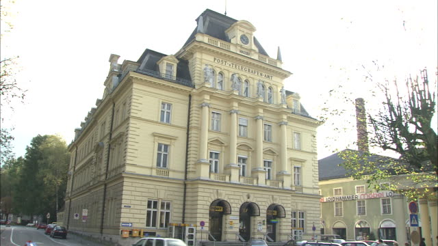 traffic passes post office building, bad ischl, austria - post office stock videos and b-roll footage