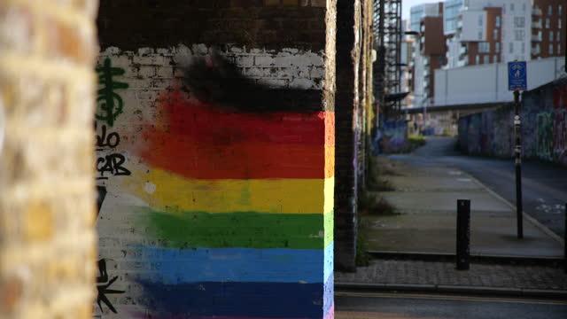 traffic passes rainbow street art in deptford, london - spectrum stock videos & royalty-free footage