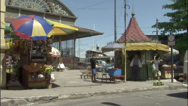 traffic passes street vendors and shoppers in manaus, brazil. - manaus stock videos and b-roll footage