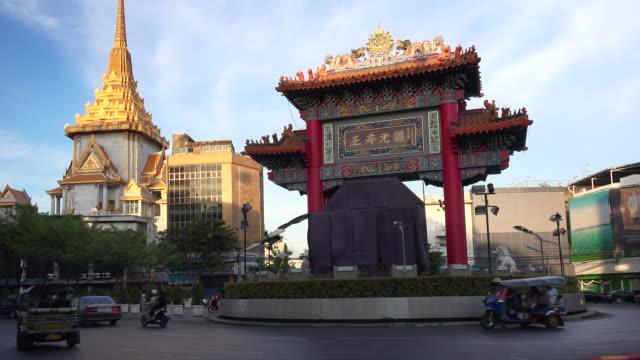 traffic passes the china gate at the entrance to chinatown in bangkok, thailand - bangkok stock videos & royalty-free footage