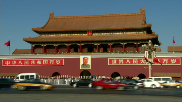traffic passes the forbidden city. - travel poster stock videos & royalty-free footage
