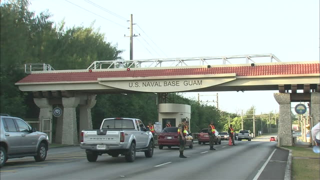 traffic passes the gate of the u.s. navy base in guam. - guam stock videos and b-roll footage