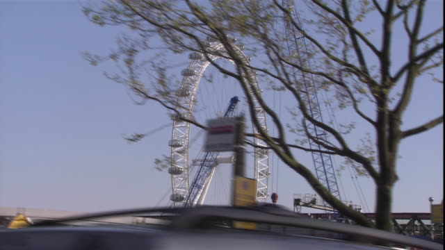 traffic passes the millennium ferris wheel and london eye in london. - 2002 stock videos & royalty-free footage