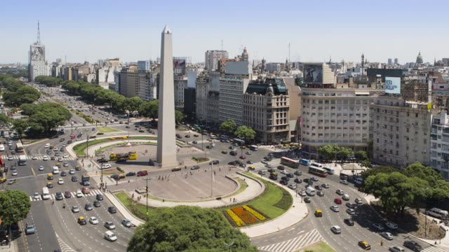 TL, MS, HA Traffic passes the obelisk / Obelisco de Buenos Aires / Buenos Aires, Argentina