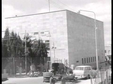 traffic passes the prison where former gestapo official adolf eichmann waits for trial. - crime or recreational drug or prison or legal trial stock-videos und b-roll-filmmaterial