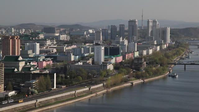 traffic passes the taedong river in pyongyang. - pyongyang stock videos and b-roll footage