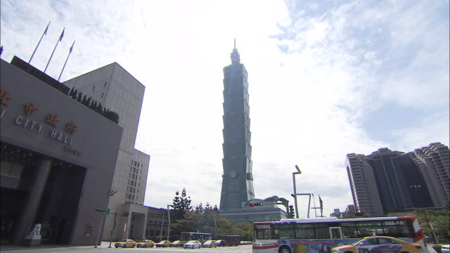 traffic passes the taipei 101 in the xinyi district of taipei - taipei 101 stock videos & royalty-free footage