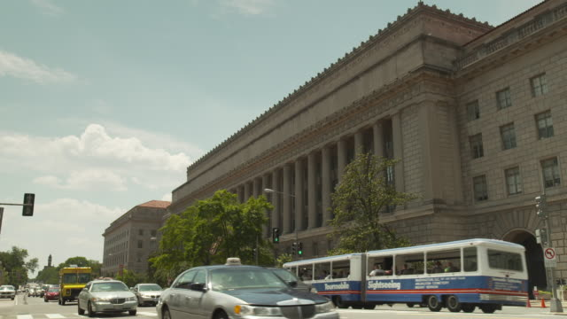 traffic passes the us department of commerce located in the herbert c. hoover building in washington, d.c., usa. - credit union stock videos & royalty-free footage