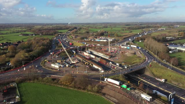traffic passes through roadworks and junction improvements at junction 19 of the m6 motorway on november 25, 2020 in knutsford, england. chancellor... - grass family stock videos & royalty-free footage