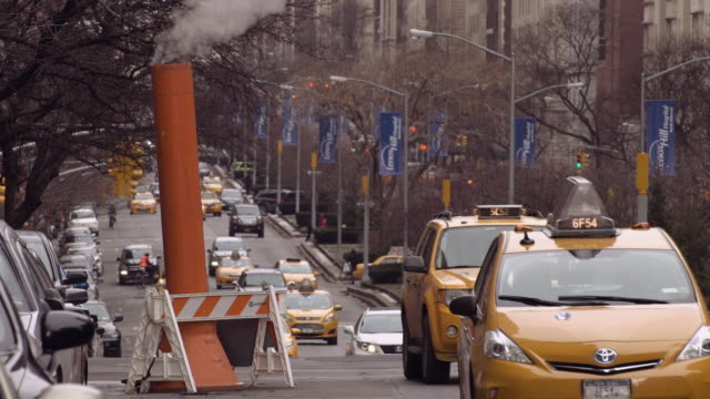 Traffic Passing a Park Avenue Smoke Stack on a Winter Day