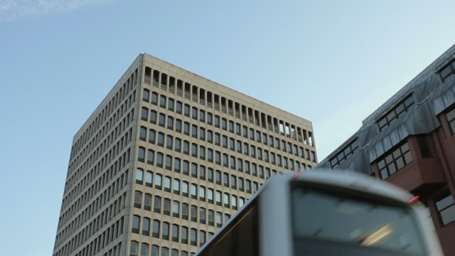 traffic passing below office block - bristol england stock videos and b-roll footage