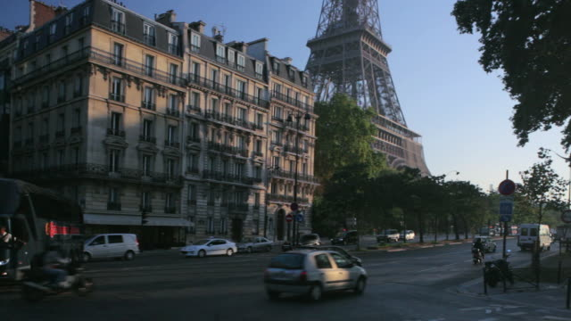 pan traffic passing by eiffel tower on the quai branly / paris, france - anamorphic stock videos and b-roll footage