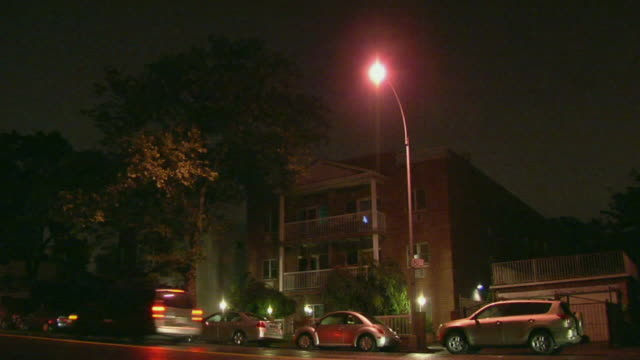 WS Traffic passing in front of apartment building at night/ Windsor Terrace, Brooklyn, NY