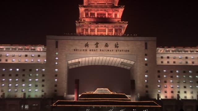 ms zo traffic passing in front of beijing west railway station/ beijing, china - 英字点の映像素材/bロール
