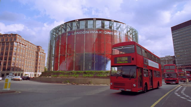 pan traffic passing in front of imax theater / london, england - film industry stock videos & royalty-free footage