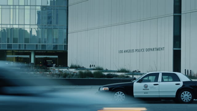 traffic passing lapd headquarters - los angeles police department stock videos & royalty-free footage