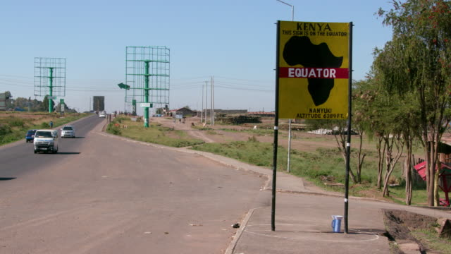 Traffic Passing The Equator Sign Nanyuki  Kenya