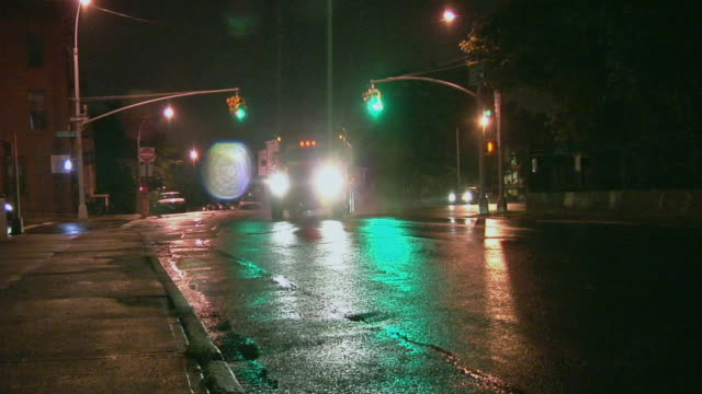 WS Traffic passing through intersection on rainy night / Windsor Terrace, Brooklyn, NY