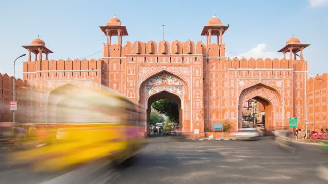 traffic passing through one of the city gates in jaipur, rajastan, india - rajasthan stock videos and b-roll footage
