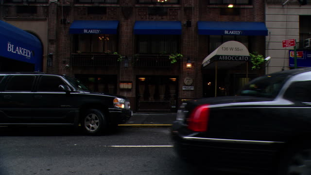 DS Traffic, pedestrians and storefronts in Midtown on Park Avenue / New York City, New York, United States