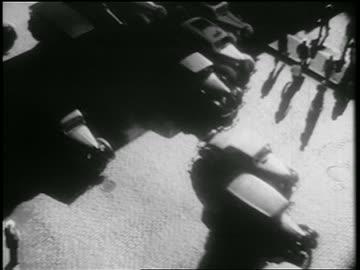 b/w 1939 overhead traffic + pedestrians on cobblestone city street / nyc / documentary - cobblestone stock videos & royalty-free footage
