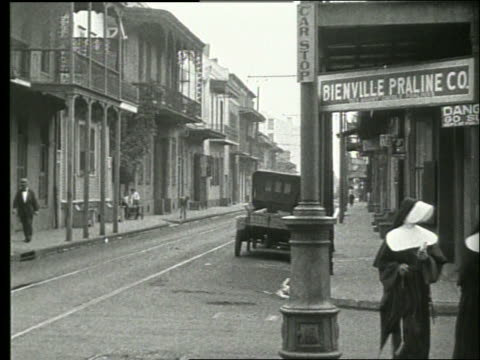 b/w traffic, people and buildings on new orleans street / nuns / 1915 / no sound - new orleans stock videos & royalty-free footage