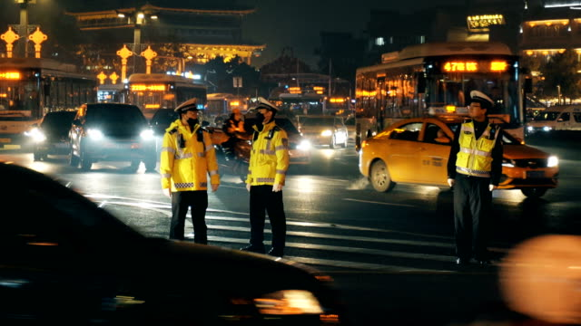 traffic police are on duty at intersections,xi'an,china. - road junction stock videos & royalty-free footage