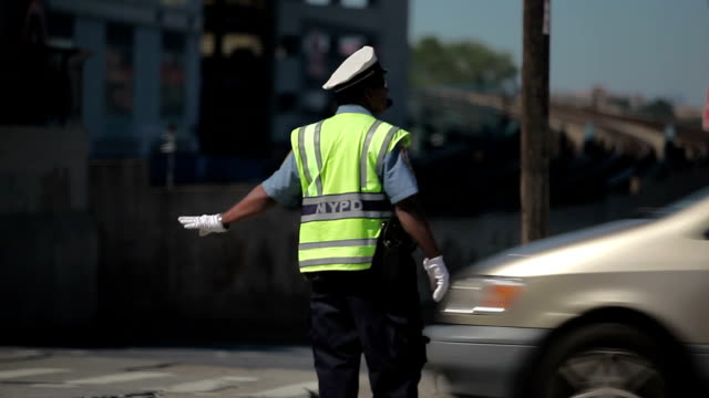 nyc traffic police directing cars - directing stock videos and b-roll footage