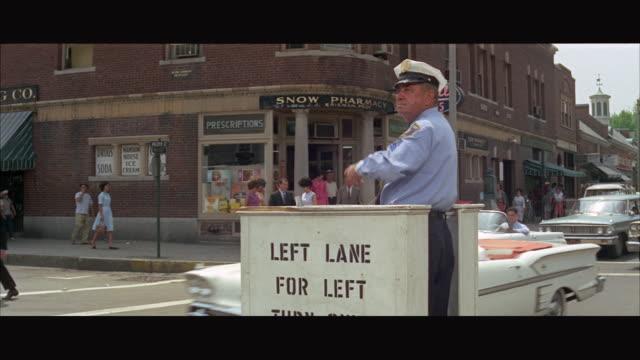 MS Traffic policeman in box in centre of street / Boston, Massachusetts, USA