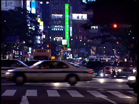 stockvideo's en b-roll-footage met traffic pours through city centre japan - 1991