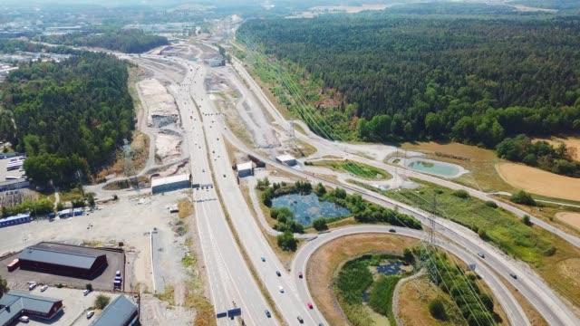 traffic roundabout highway crossing, haggvik, sollentuna, stockholm - motorway junction stock videos & royalty-free footage