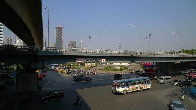 traffic sala daeng intersection area thai-japan bridge at rama 4 road bangkok thailand. - railway station stock videos & royalty-free footage