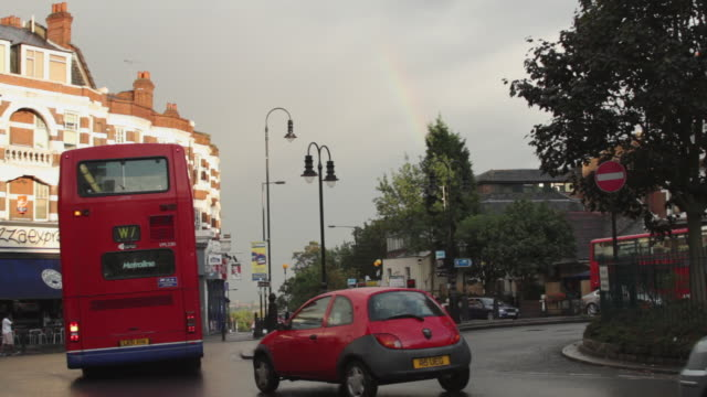 ws traffic scene on street of muswell hill / london, united kingdom - doppeldeckerbus stock-videos und b-roll-filmmaterial